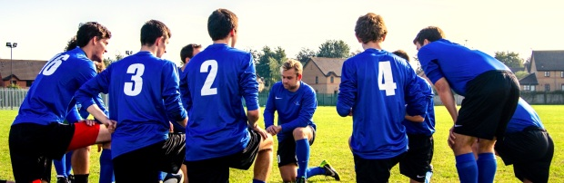 Team of Soccer players, taking a knee